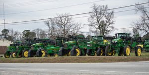 Row of farm equipment near road